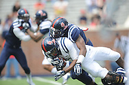 Eugene Brazley (3) is tackled by Temario Strong (32) at Mississippi's Grove Bowl controlled scrimmage at Vaught-Hemingway Stadium in Oxford, Miss. on Saturday, April 5, 2014.