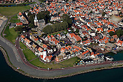 Nederland, Noordoostpolder, Urk, 08-09-2009. Voormalig eiland Urk, centrum met kade en dijk, vuurtoren en Kerkje aan Zee. Vissersplaats met grote vissersvloot, visafslag (veiling) en visverwerkende industrie. Streng gelovig dorp, veel verschillende  protestantse kerken en kerkgenootschappen. .Former island Urk, fishing port and marina. Fishing village with fish auction and fish processing industry. Strict religious village, many Protestant churches and denominations. .(toeslag); aerial photo (additional fee required); .foto Siebe Swart / photo Siebe Swart
