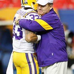 Dec 3, 2011; Atlanta, GA, USA;LSU Tigers head coach Les Miles and wide receiver Odell Beckham (33) prior to kickoff of a game Georgia Bulldogs during the 2011 SEC championship game at the Georgia Dome.  Mandatory Credit: Derick E. Hingle-US PRESSWIRE