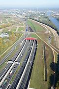 Nederland, Utrecht, Utrecht, 24-10-2013;<br /> Rijksweg A2 en de zuidelijke ingang van de  Leidsche Rijntunnel, een landtunnel die de verkeersoverlast, luchtvervuiling en geluidsoverlast voor Utrecht en de Vinexwijk Leidsche Rijn moet verminderen. Rechts het Amsterdam-Rijnkanaal  met de stad Utrecht. Stadsbaan links van de tunnel.<br /> Roadway A2 and the southern entrance to the tunnel Leidsche Rijn, a landtunnel built to decrease the nuisance of traffic noise and air pollution for the city of Utrecht and the suburb Leidsche Rijn (l) . Right the Amsterdam-Rhine Canal and the city of Utrecht.<br /> luchtfoto (toeslag op standaard tarieven);<br /> aerial photo (additional fee required);<br /> copyright foto/photo Siebe Swart.
