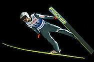 Piotr Zyla of Poland competes during FIS World Cup Ski Jumping competition in Wisla, Poland on January 16, 2014.<br /> <br /> Poland, Wisla, January 16, 2014.<br /> <br /> Picture also available in RAW (NEF) or TIFF format on special request.<br /> <br /> For editorial use only. Any commercial or promotional use requires permission.<br /> <br /> Mandatory credit:<br /> Photo by © Adam Nurkiewicz / Mediasport