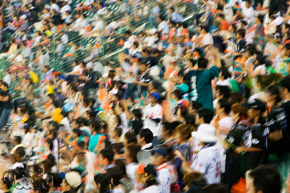 Japan Kobe Yahoo Stadium crowd of people watching baseball match motion blur