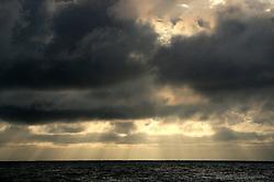 NORTHERN PACIFIC ESPERANZA 7NOV07 - Rays of sunlight penetrate between the clouds before sunset seen from aboard the MY Esperanza in the northern Pacific...jre/Photo by Jiri Rezac..© Jiri Rezac 2007..Contact: +44 (0) 7050 110 417.Mobile:  +44 (0) 7801 337 683.Office:  +44 (0) 20 8968 9635..Email:   jiri@jirirezac.com.Web:    www.jirirezac.com..© All images Jiri Rezac 2007 - All rights reserved.