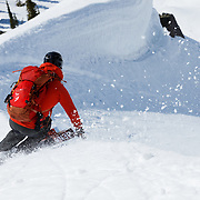 David Steele kicking up snow with his bear spray while skiing back into basecamp.
