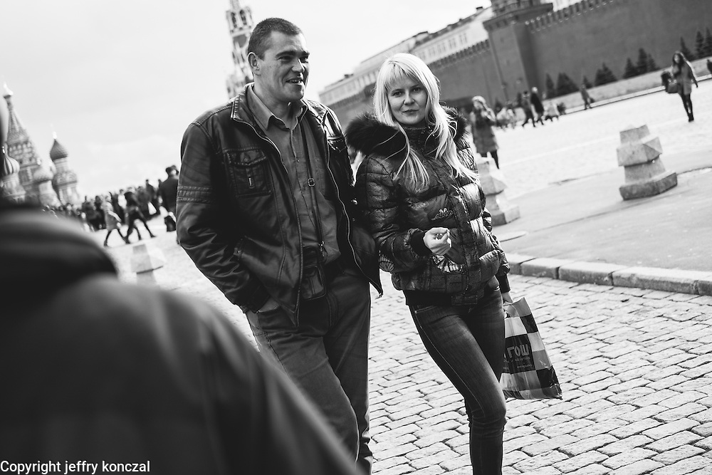 A couple walk through Red Square in Moscow, Russia.