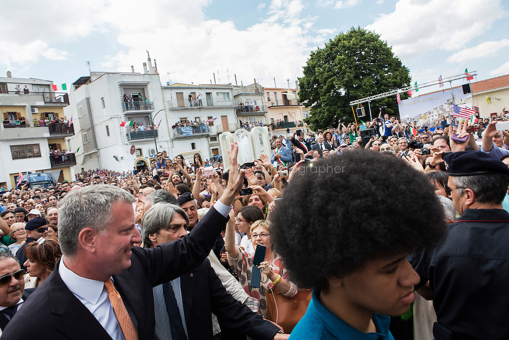 GRASSANO, ITALY - 24 JULY 2014: Mayor of New York Bill de Blasio waves to the crowd upon his arrival in Grassano, his ancestral home town in Italy, on July 24th 2014.<br /> <br /> New York City Mayor Bill de Blasio arrived in Italy with his family Sunday morning for an 8-day summer vacation that includes meetings with government officials and sightseeing in his ancestral homeland.