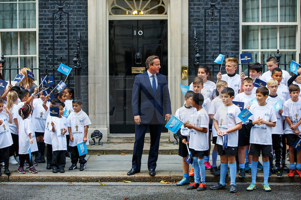 © Licensed to London News Pictures. 17/09/2015. London, UK. Prime Minister David Cameron meeting school children from the Rugby World Cup's host boroughs before welcoming the Webb Ellis Cup to Number 10 Downing Street, the day before the start of the Rugby World Cup on Thursday, 17 September 2015. Photo credit: Tolga Akmen/LNP