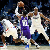 12 October 2017: Sacramento Kings guard Frank Mason III (10) drives past `LA Clippers Jawun Evans (1) and LA Clippers guard C.J. Williams (9) during the LA Clippers 104-87 victory over the Sacramento Kings, at the Staples Center, Los Angeles, California, USA.