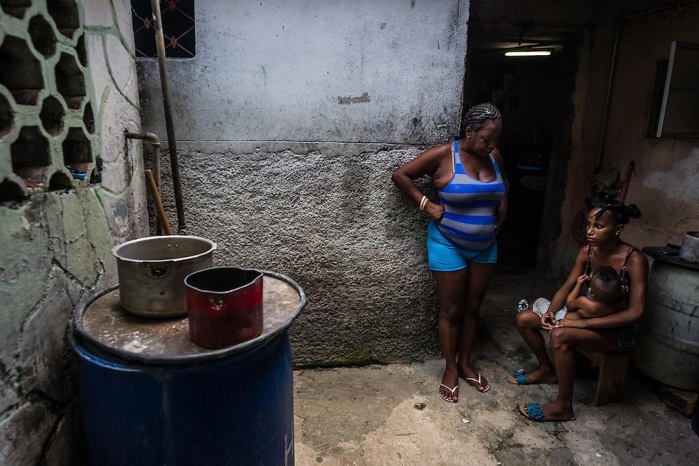 HAVANA, CUBA - JUNE 18, 2015: Taylin Martinez Diaz, 40, watches as her daughter, Sailen Urquia Martinez, 17, nurses her 2-year-old son, Aroldi Diovis Duran Urquia outside of their home in Central Havana.  Both Martinez and Urquia are happy that diplomatic relations are being restored between Cuba and The United States. They believe Aroldi will have more economic opportunites and a brighter future if he can grow up without the economic embargo.  PHOTO: Meridith Kohut for The New York Times