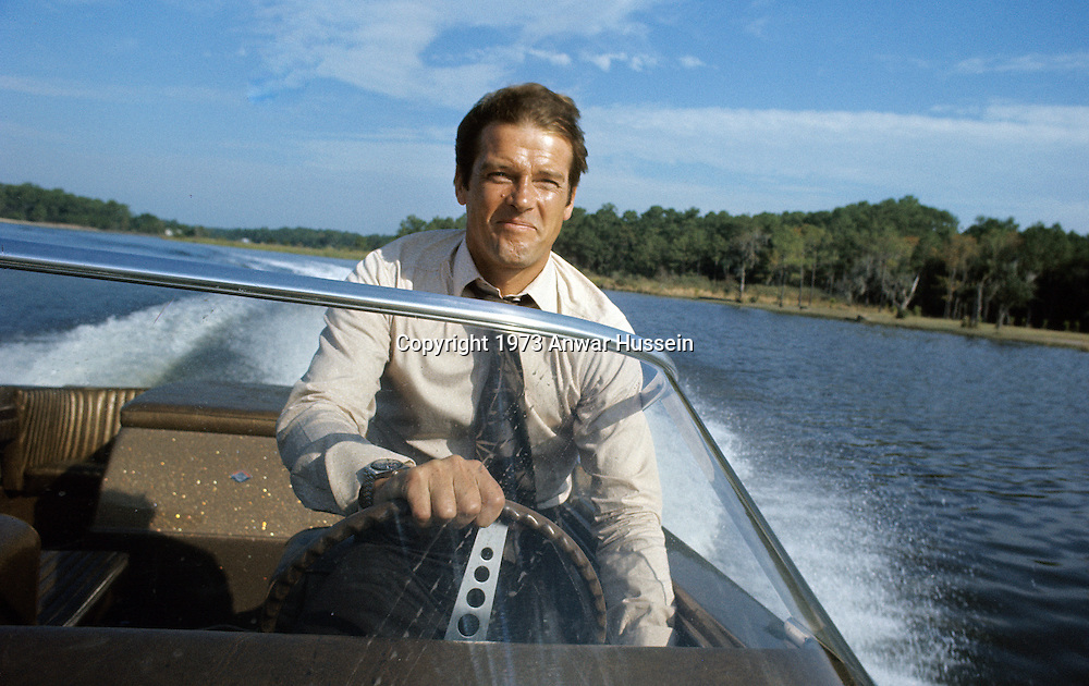 Roger Moore poses on location for the filming of James Bond film 'Live And Let Die' on March 1, 1973 in Kingston, Jamaica.