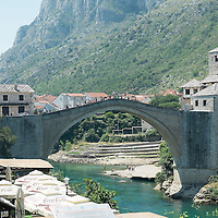 MOSTAR, BOSNIA AND HERZEGOVINA - JUNE 26:  A general view of the Old Bridge on  June 26, 2013 in Mostar, Bosnia and Herzegovina.The Siege of Mostar reached its peak and more cruent time during 1993. Initially, it involved the Croatian Defence Council (HVO) and the 4th Corps of the ARBiH fighting against the Yugoslav People's Army (JNA) later Croats and Muslim Bosnian began to fight amongst each other, it ended with Bosnia and Herzegovina declaring independence from Yugoslavia.  (Photo by Marco Secchi/Getty Images)