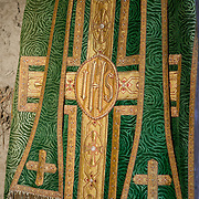 Priest's Robe in green and gold, hangs in a preparation room. Idaho, Shoshone County, Cataldo Mission.