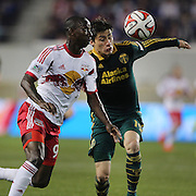 Bradley Wright-Phillips, (left), New York Red Bulls, is challenged by Jorge Villafana, Portland Timbers, during the New York Red Bulls Vs Portland Timbers, Major League Soccer regular season match at Red Bull Arena, Harrison, New Jersey. USA. 24th May 2014. Photo Tim Clayton