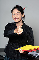 cute funny young expressive women asian working woman at the office thumb up