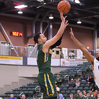 5th year guard Aaron McGowan (1) of the Regina Cougars in action during the home game on November  5 at Centre for Kinesiology, Health and Sport. Credit: /Arthur Images