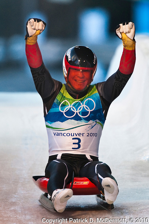 Felix Loch, GER, celebrates his victory after finishing his fourth run of the Men's Single Luge competition during the 2010 Vancouver Winter Olympics at the Whistler Sliding Centre in Whistler, British Columbia, Sunday, Feb. 14, 2010. Loch finished ahead of his teamate David Moeller by 0.679 seconds to earn him the gold medal.