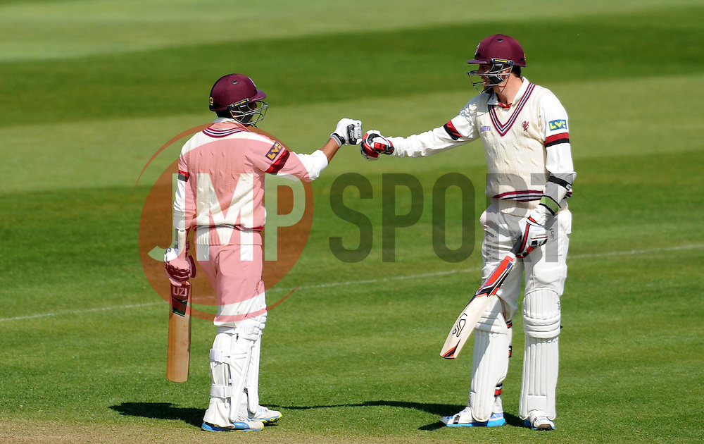 Somerset's Abdur Rehman is congratulated by Jamie Overton after reaching his half century. - Photo mandatory by-line: Harry Trump/JMP - Mobile: 07966 386802 - 14/04/15 - SPORT - CRICKET - LVCC County Championship - Day 3 - Somerset v Durham - The County Ground, Taunton, England.