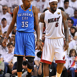 Jun 17, 2012; Miam, FL, USA; Oklahoma City Thunder small forward Kevin Durant (35) and Miami Heat small forward LeBron James (6) during the third quarter in game three in the 2012 NBA Finals at the American Airlines Arena. Mandatory Credit: Derick E. Hingle-US PRESSWIRE