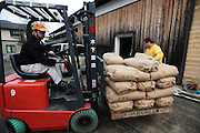 Master sake brewer Philip Harper from the United Kingdom transports sacks of rice at the Tamagawa Sake Brewery in Kyoto, Japan. More than 1,200 sake breweries exist in Japan, though falling domestic consumption has lead some to look to  overseas markets. Photographer: Robert Gilhooly