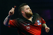 Michael Smith celebrates his win over Luke Humphries by throwing his darts in the crowd during the World Darts Championships 2018 at Alexandra Palace, London, United Kingdom on 29 December 2018.