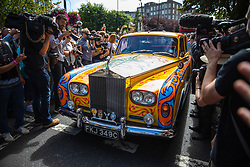 © Licensed to London News Pictures. 08/08/2019. London, UK. A decorated Rolls Royce arrives at the zebra crossing outside the Abbey Road studios in north London. The Beatles were photographed for the Abbey Road album cover 50 years ago today by Iain Macmillan. Photo credit: Rob Pinney/LNP