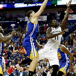 Dec 13, 2016; New Orleans, LA, USA;  New Orleans Pelicans guard Jrue Holiday (11) shoots over Golden State Warriors guard Klay Thompson (11) during the second half of a game at the Smoothie King Center. The Warriors defeated the Pelicans 113-109. Mandatory Credit: Derick E. Hingle-USA TODAY Sports