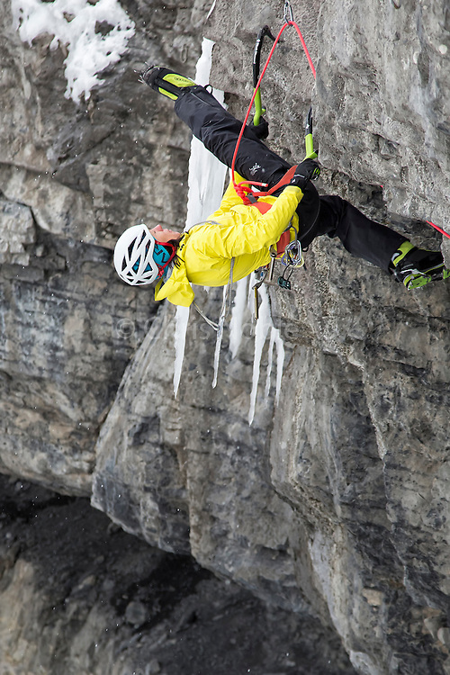 """Former world champion  mixed climber Ines Papert doing a """"figure four"""" while attempting an unclimbed project on """"Stairway to Heaven"""" in Provo Canyon Utah"""