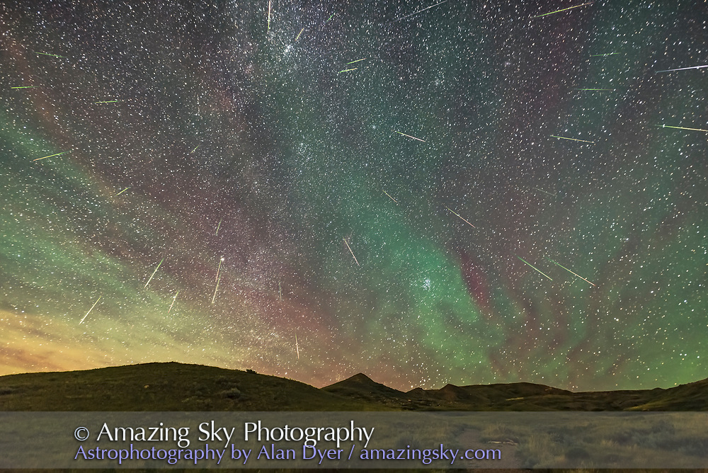 "A composite of the Perseid meteor shower, on the peak night, Aug 11/12, 2016, looking northeast to the radiant point in Perseus left of centre, with the Pleiades and Hyades clusters in Taurus rising. There are 33 meteors here. Note the fairly consistent green to red tint of each meteor streak. A couple of streaks look more white and might be flaring satellites though their trajectory matches where a Perseid should be.  The sky is also filled with bands of red and green airglow which in the time-lapse sequence are moving from south to north, right to left here. The airglow was bright enough that it was visible to the unaided eye as grey bands in the sky, especially the ""cloud"" around the Pleiades.  The reddish/orange patches at upper left are the remains of a long-lived ""smoke"" trail from an expoding meteor earlier in the evening, which I of course missed capturing.   This was taken from the Dark Sky Preserve of Grasslands National Park, Saskatchewan, from the trailhead parking lot at the end of the 70 Mile Butte Road.   This is a stack of 31 frames containing meteors (two frames had 2 meteors), shot from 1:13 am to 2:08 a.m. CST, so over 55 minutes. So considering the camera would have missed the fainter meteors and is seeing only one section of the sky, 33 meteors over 55 minutes is a great count, translating to perhaps ~ 100 to 150 over the whole sky? This is from latitude 49° N.  The camera was not tracking the sky but was on a fixed tripod. I choose one frame with the best visibility of the airglow as the base layer. For every other meteor layer, I used Free Transform to rotate each frame around a point far off frame at upper left, close to where the celestial pole would be and then nudged each frame to bring the stars into close alignment with the base layer, especially near the meteor being layered in. This placed each meteor in its correct position in the sky in relation to the stars, essential for showing the effect of the radiant point accurately."
