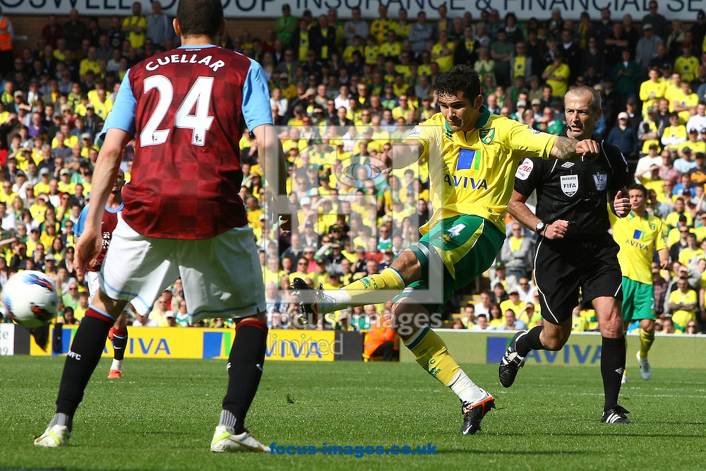 Picture by Paul Chesterton/Focus Images Ltd.  07904 640267.13/05/12.Bradley Johnson of Norwich has a shot on goal during the Barclays Premier League match at Carrow Road Stadium, Norwich.