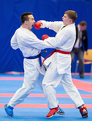 Haris Jahic (blue) of Slovenia fighting against Team of Ukraine (red) during of Kumite Team male at Day Two of Karate 1 World Cup - Thermana Slovenia Lasko 2014 tournament, on March 16, 2014 in Arena Tri Lilije, Lasko, Slovenia.Photo by Vid Ponikvar / Sportida