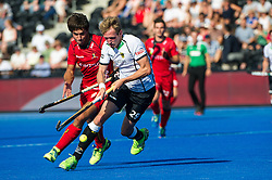 Germany's Niklas Wellen is watched by Alexander Hendrickx of Belgium. Belgium v Germany - Unibet EuroHockey Championships, Lee Valley Hockey & Tennis Centre, London, UK on 22 August 2015. Photo: Simon Parker