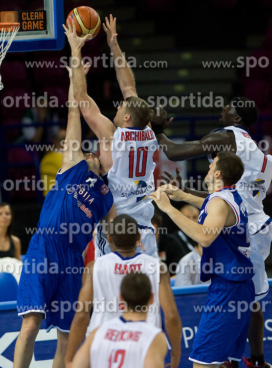 Novica Velickovic vs Robert Archibald of GB during the basketball match at 1st Round of Eurobasket 2009 in Group C between Serbia vs Great Britain, on September 09, 2009 in Arena Torwar, Warsaw, Poland. Slovenia won 84:76. (Photo by Vid Ponikvar / Sportida)