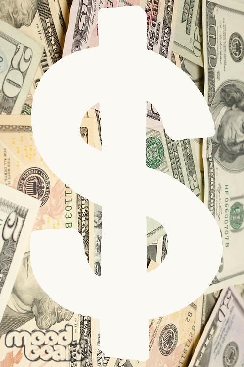 Digital composite image of dollar sign over banknotes