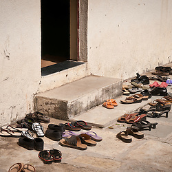 Pairs of shoes block the entrance to the training center.