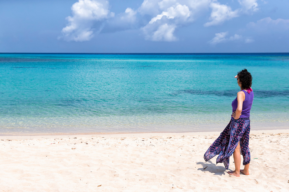 Woman on beach in Playa La Herradura, Las Tunas, Cuba.