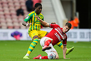 Middlesbrough midfielder Paddy McNair (17) is fouled by West Bromwich Albion defender Nathan Ferguson (36) during the EFL Sky Bet Championship match between Middlesbrough and West Bromwich Albion at the Riverside Stadium, Middlesbrough, England on 19 October 2019.