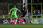 Forest Green Rovers goalkeeper James Montgomery saves at the feet of Mansfield Town's Gethin Jones(20) during the EFL Sky Bet League 2 match between Forest Green Rovers and Mansfield Town at the New Lawn, Forest Green, United Kingdom on 29 January 2019.