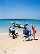 Longtail boar, jet ski and baby stroller on Karon Beach