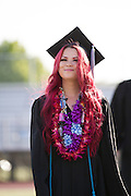 Senior Lauren Guzzetta looks into the Milpitas High School bleachers as she walks with the Call Hills Class of 2012 processional on June 15, 2012.  Photo by Stan Olszewski/SOSKIphoto.