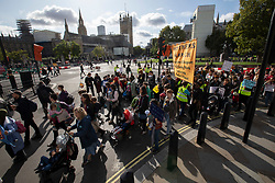 © Licensed to London News Pictures. 09/10/2019. London, UK. An Extinction Rebellion Mothers March passes through Parliament square . Police continue to attempt to clear roads in Westminster on the third day of the protest.  Photo credit: George Cracknell Wright/LNP