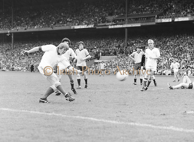 Dublin player just after he kicks the ball towards the goalmouth during the Kerry v Dublin All Ireland Senior Gaelic Football Final in Croke Park on the 24th of September 1978. Kerry 5-11 Dublin 0-9.