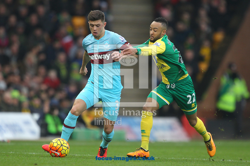 Nathan Redmond of Norwich and Aaron Cresswell of West Ham in action during the Barclays Premier League match at Carrow Road, Norwich<br /> Picture by Paul Chesterton/Focus Images Ltd +44 7904 640267<br /> 13/02/2016