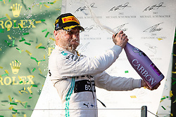 March 17, 2019 - Albert Park, VIC, U.S. - ALBERT PARK, VIC - MARCH 17: Mercedes-AMG Petronas Motorsport driver Valtteri Bottas enjoys the champagne at The Australian Formula One Grand Prix on March 17, 2019, at The Melbourne Grand Prix Circuit in Albert Park, Australia. (Photo by Speed Media/Icon Sportswire) (Credit Image: © Steven Markham/Icon SMI via ZUMA Press)