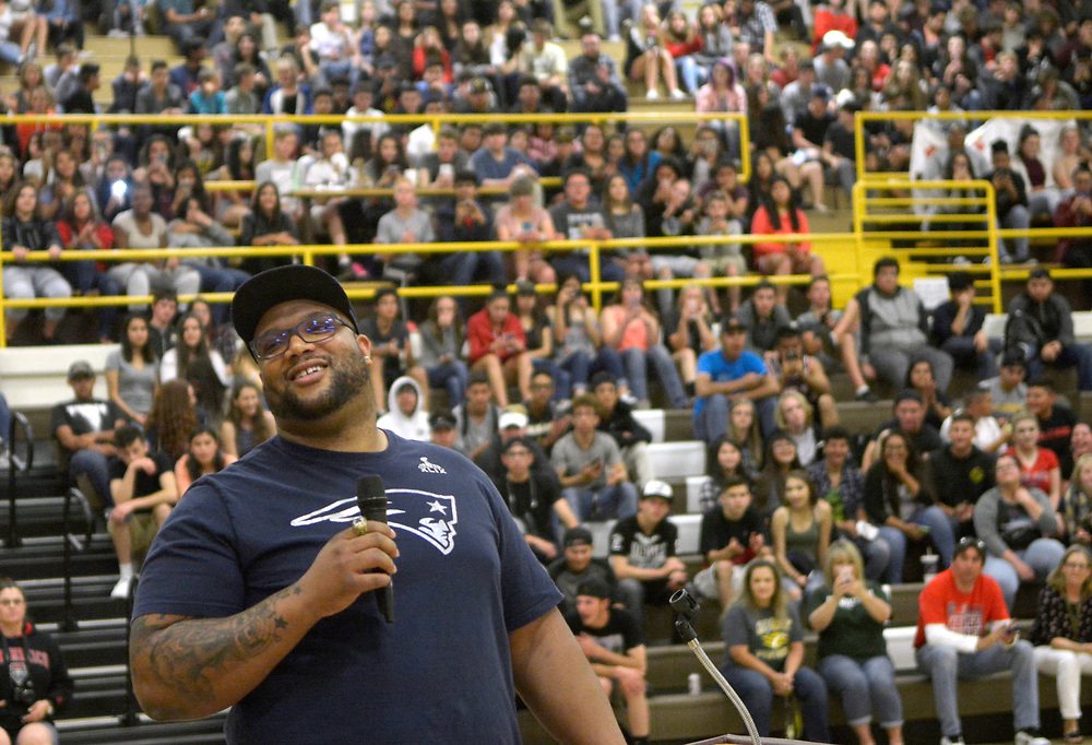 gbs050417n/SPORTS -- Former Cibola football player and current New England Patriots and Super Bowl Champion, Alan Branch, talks to students during a program honoring him at Cibola on Wednesday, May 3, 2017. (Greg Sorber/Albuquerque Journal)