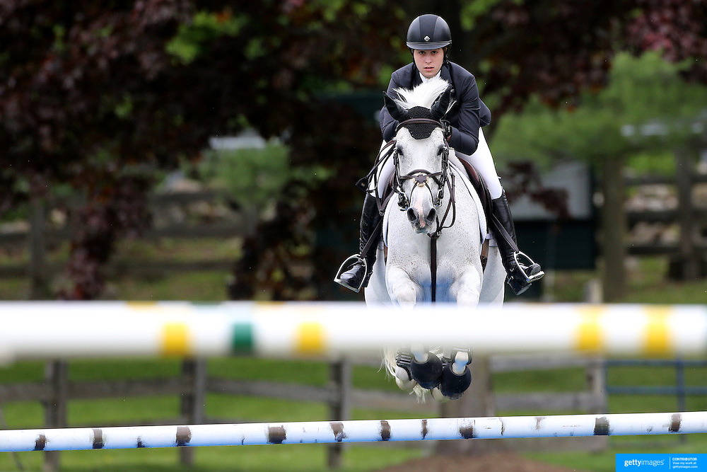 NORTH SALEM, NEW YORK - May 21: Madison Goetzmann riding Wrigley in action during The $15,000 Under 25 T & R Development Grand Prix at the Old Salem Farm Spring Horse Show on May 21, 2016 in North Salem, New York. (Photo by Tim Clayton/Corbis via Getty Images)