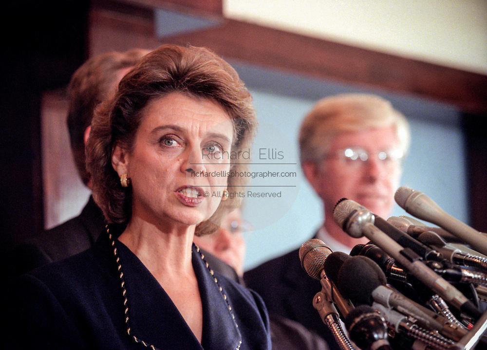 Washington Attorney General Christine Gregoire with other state attorneys general discusses a $206 billion settlement with tobacco companies November 16, 1998 in Washington, DC.