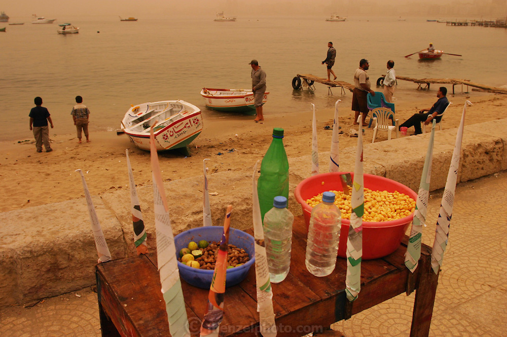 Garbanzo beans for sale in paper cones by the port in Alexandria, Egypt. The sky and light are orange due to a sandstorm. (Supporting image from the project Hungry Planet: What the World Eats.).