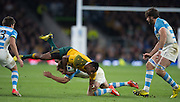 Twickenham. Great Britain,   Tevita KURIDRANI, tackled by Nicolas SANCHEZ, during, Semi Final. Australia vs Argentina  2015 Rugby World Cup,  Venue, Twickenham Stadium, Surrey England.   Sunday  25/10/2015   [Mandatory Credit; Peter Spurrier/Intersport-images]