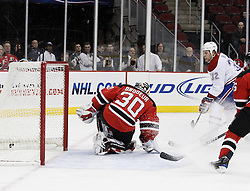 Dec 16, 2009; Newark, NJ, USA; Montreal Canadiens left wing Travis Moen (32) scores past New Jersey Devils goalie Martin Brodeur (30) during the first period at the Prudential Center.