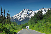 Camper traveling on the Stewart Cassiar Highway and mountains<br /> Stewart Cassiar Highway<br /> British Columbia<br /> Canada